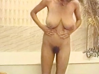 Busty retro whore Mandy lapdances totally...