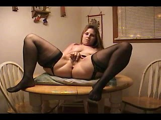 Fat mature bitch masturbating her meaty pussy...