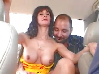 Sexy brunette amateur MILF shows off tits and...