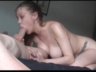 Hot amateur wife with huge tits licking cock...