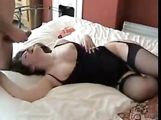 Amateur milf in black stockings riding cock
